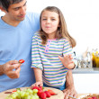 Little girl and her father having breakfast — Stock Photo #10826788