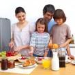 Cheerful family having a breakfast — Stock Photo