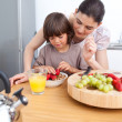 Stock Photo: Smiling mother and her child having breakfast