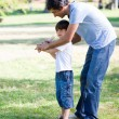 Loving little boy playing baseball with his father — Stock Photo #10826863