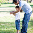 Loving little boy playing baseball with his father — Stock Photo