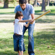 Stock Photo: Positive father teaching baseball to his son