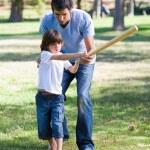 Positive father teaching baseball to his son — Stock Photo