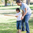 Charming father teaching baseball to his son — Stock Photo