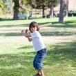 Adorable little boy playing baseball — Stock Photo