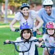 Stock Photo: Cheerful family riding a bike