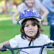 Adorable little boy riding a bike - Zdjęcie stockowe