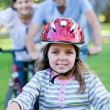 Cute little girl riding a bike - Foto Stock