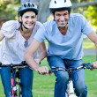 Animated couple riding a bike - Foto Stock