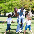 Lively family playing soccer — Stock Photo #10826910