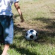 Little boy playing soccer — Stock Photo