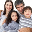 Portrait of a loving family sitting on a sofa - Foto Stock