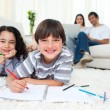 Cute children drawing lying on the floor — Stock Photo #10826948