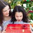 Mother and daughter playing with Christmas gifts — Stockfoto #10826962