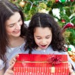 Mother and daughter playing with Christmas gifts — 图库照片 #10826962