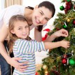 Mother and daughter at home at Christmas time — Stock Photo #10826974