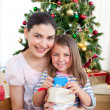 Mother and daughter at home at Christmas time — Stock Photo #10826984