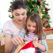 Mother and daughter at home at Christmas — Stock Photo #10826993