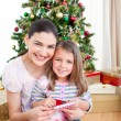 Stock Photo: Mother and daughter at home at Christmas