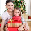 Mother and daughter at home at Christmas time — Stock Photo #10827000