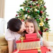 Mother and daughter at home at Christmas — Stok fotoğraf