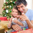Father and little girl playing with Christmas presents — ストック写真