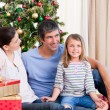 Family having fun with Christmas presents — Stock Photo