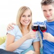 Cute couple drinking wine together in living-room — Stock Photo #10827129