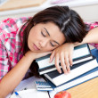 Close-up of a tired caucasian teen girl studying — Stock Photo #10827161