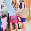 Stock Photo: United women choosing clothes together