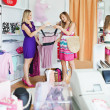 Young women choosing clothes together — Stock Photo