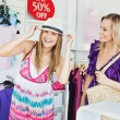 Stock Photo: Jolly women choosing clothes together