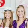 Stock Photo: Cute women choosing clothes together