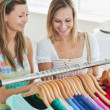 Stock Photo: Caucasiwomen choosing clothes together