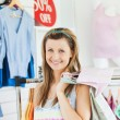 Cute woman choosing clothes — Stock Photo
