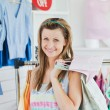 Smiling woman choosing clothes — Stock Photo