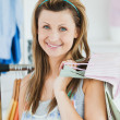 Happy woman choosing clothes — Stock Photo #10827451