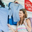 Delighted woman choosing clothes — Stock Photo