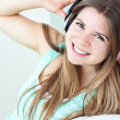 Charming girl listening to music — Stock Photo #10827482