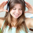 Good-looking girl listening to music — Foto de Stock