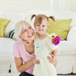 Blond woman get surprise by her daughter — Stock Photo