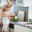 Concentrated mother and child cooking — Stock Photo