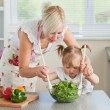 Blond mother and child cooking — Stock Photo