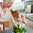 Bright mother and child cooking — Stock Photo #10827712