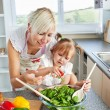 Attractive mother and child cooking — Stock Photo