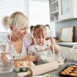 Sweet girl baking cookies — Stock Photo