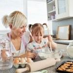 Sweet girl baking cookies — Stock Photo