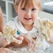 Sweet child baking cookies with hands — Stock Photo