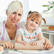 Stockfoto: Kind mother and child baking cookies