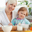 Royalty-Free Stock Photo: Radiant mother and daughter having breakfast